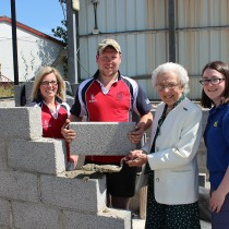 Mrs Mary Trimble MBE lays a brick at the new Rathfriland YFC hall on Downpatrick Street assisted by club leader Christopher Simpson as Club President Rosemary McConnell and Vice President Rebecca McConnell look on.